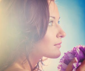 26750481 - beautiful woman with big flower on blue background