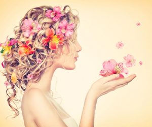 29096077 - beauty girl takes beautiful flowers in her hands